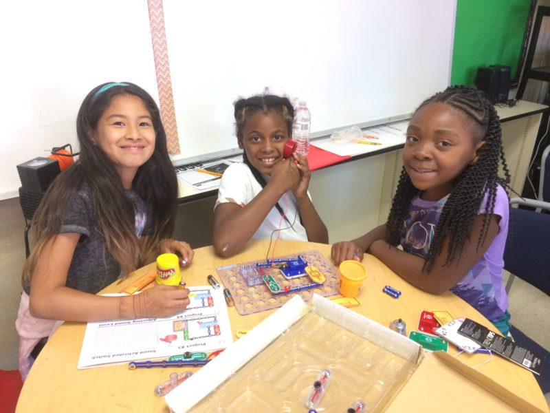 Diverse Children Sitting at a Table doing an Activity
